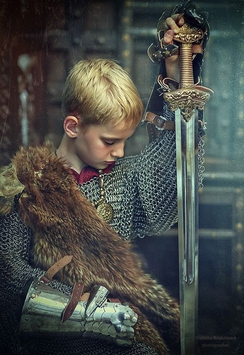 His mentor looked over at him. The sword was taller than the boy, but he bravely held it up.