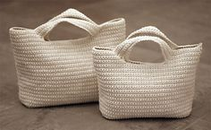 Make with one handle loop and hand on pegs?  Ravelry: Starling Handbag pattern by Alice Merlino