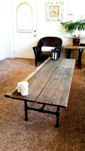 Barn door repurposed into a coffee table. Made by Resurrected Goods. Follow us on Facebook!