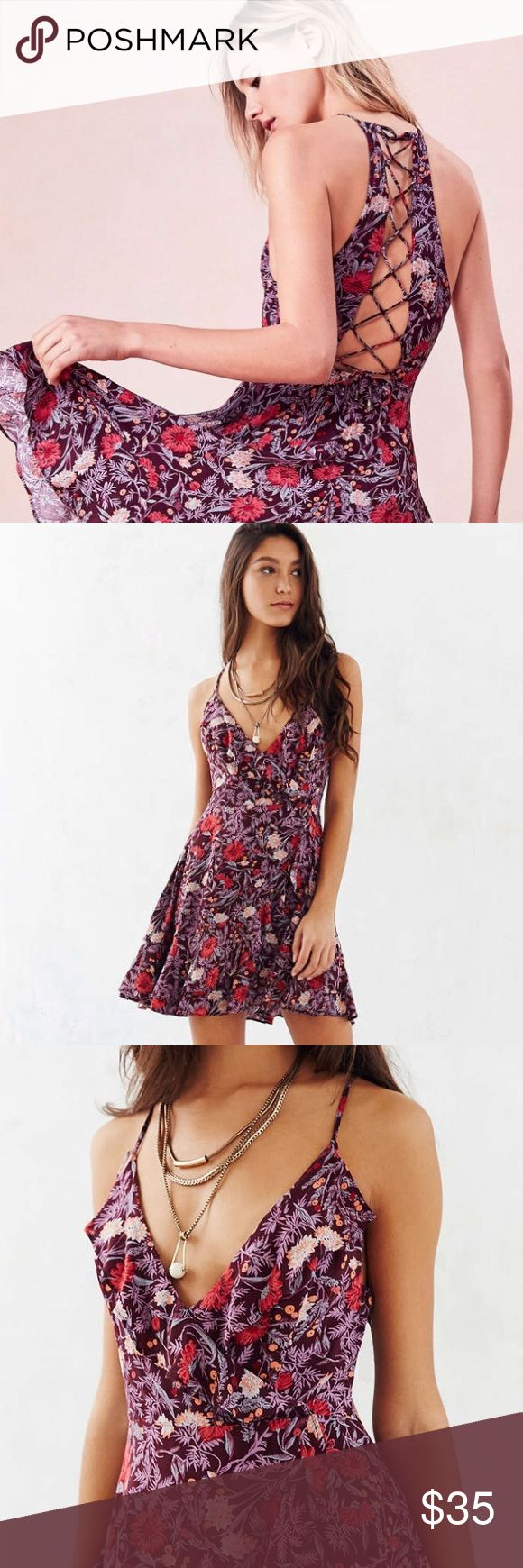 Kimchi Blue Wrap Dress Super cute dress in a pretty floral pattern! Size 0, fits XS-S. Worn once to a wedding and it was comfy and perfect for dancing  Urban Outfitters Dresses Mini