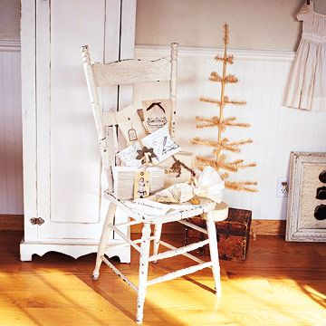 Vintage-White Christmas Decorating:   Simple holiday decorating touches bring Christmas to the quiet vintage style of this antique-white home. Simple, Sophisticated Packaging:   Packaging is a gift in itself. Vintage newspapers and scripted prints create wrap truly worth saving, along with stick-to-the-theme embellishments of cream-colored ribbons, tinsel, and crepe paper.