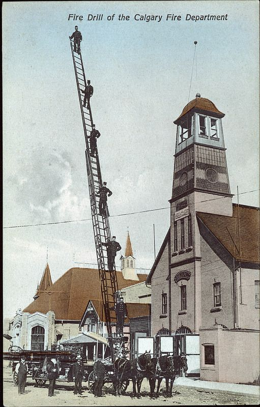 Calgary Fire Department headquarters located at 122 7th Avenue SE. The department's horse-drawn aerial ladder is shown extended to 75 feet with firemen on it. This building served as the Fire Department headquarters from 1887 until 1911. Knox Church is visible behind the ladder.