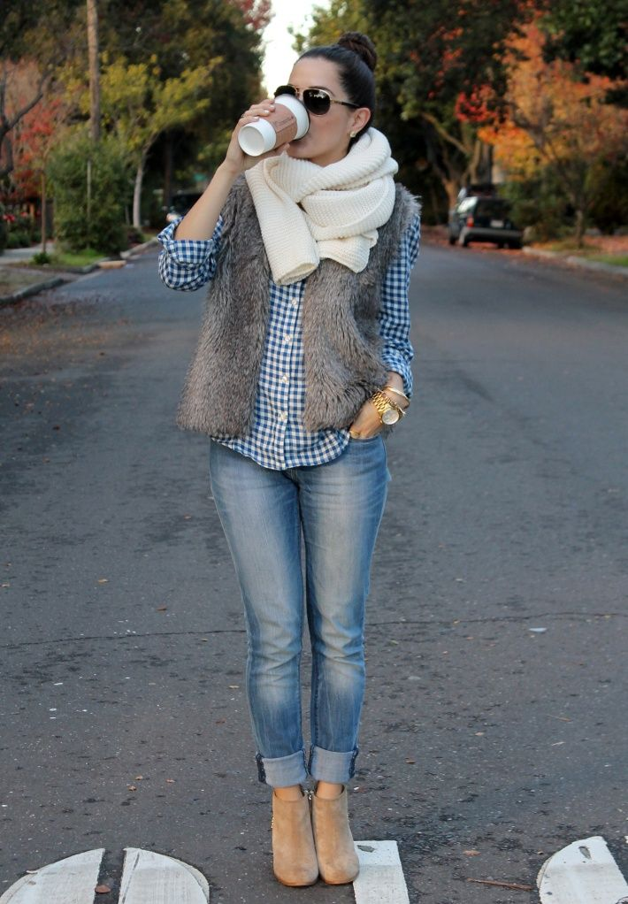 Team a grey fur vest with blue slim jeans to create a chic, glamorous look. Elevate your getup with tan suede booties.  Shop this look for $136:  http://lookastic.com/women/looks/sunglasses-scarf-vest-dress-shirt-watch-skinny-jeans-ankle-boots/5538  — Dark Brown Sunglasses  — Beige Knit Scarf  — Grey Fur Vest  — Navy and White Gingham Dress Shirt  — Gold Watch  — Blue Skinny Jeans  — Tan Suede Ankle Boots