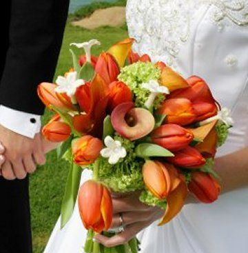 Orange tulips and calla lilies with mini hydrangeas - http://www.wedding-flowers-and-reception-ideas.com/images/fall-bridal-bouquets-02.jpg
