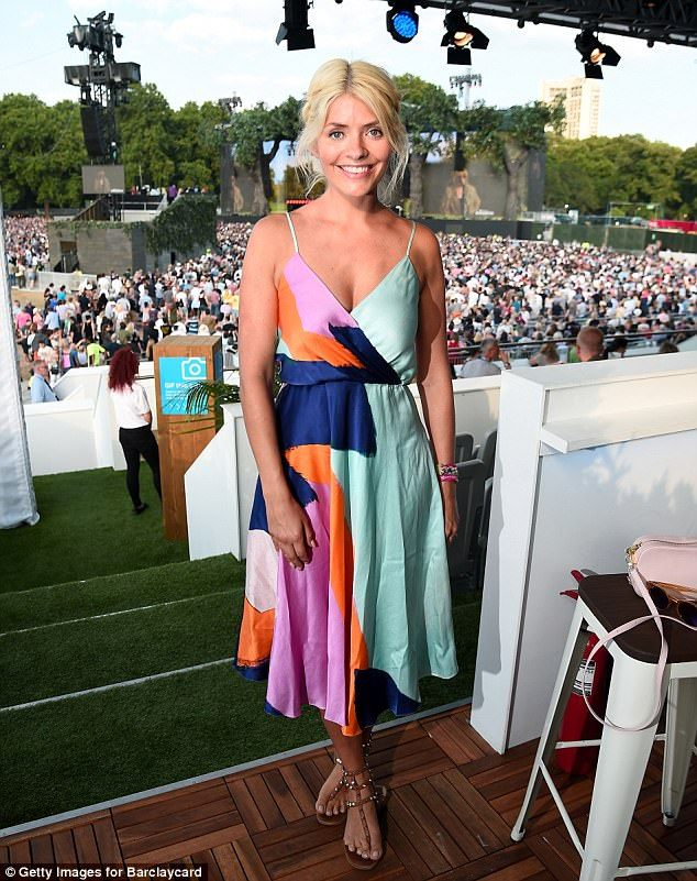 Gorgeous: The This Morning presenter commanded attention as she stepped out in a vibrant w...