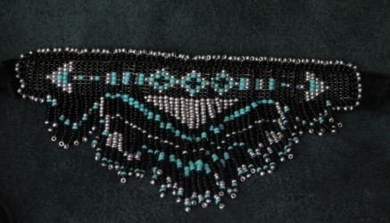 """Bring out your inner """"Buffy"""" (you know which one we mean) with this beautiful choker made with turquoise/silver/and black glass two-cut seed beads. Just check out that stepped fringe. $50. By Sister Bear Designs."""