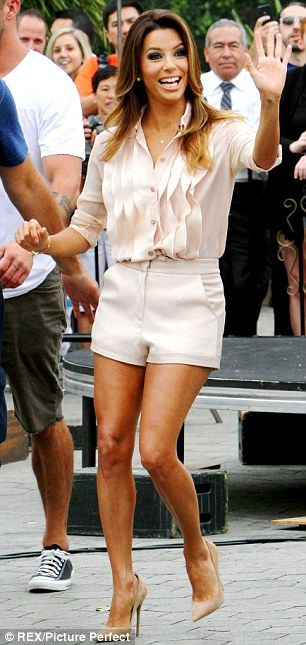 Pin parade: The Desperate Housewives star flaunted her toned and tan pins in peachy formal shorts, a matching blouse, and nude pumps