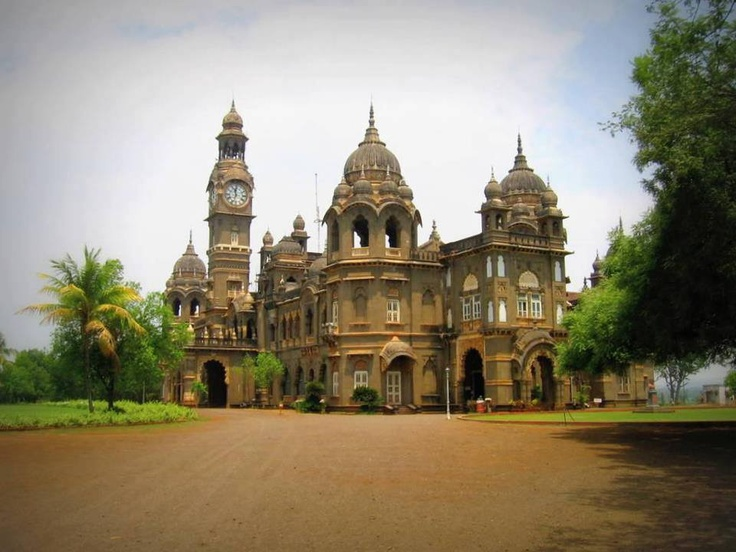 The New Palace, Kolhapur, Maharashtra.  This is where my daddy was born, he told me he use to hear the clock every night as a kid.