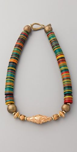 This antiqued gold-plated necklace features plastic, geometric, and polished beads. Hook-and-eye clasp. by Vanessa Mooney