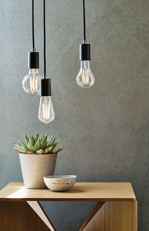The Beacon Lighting LEDlux Karbon 5.5W BC clear G95 450 lumen decorative filament globe in warm white.