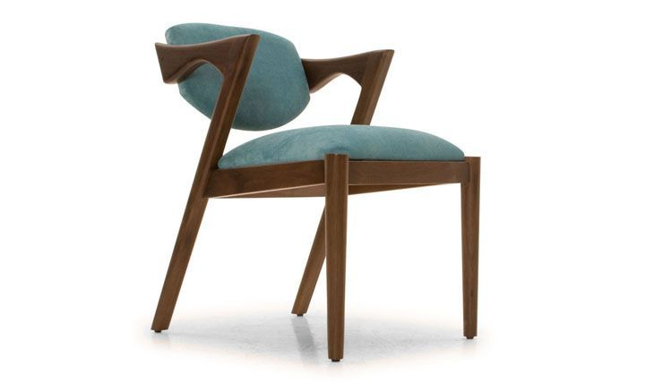 With architecturally inspired lines and the natural beauty of exposed wood, this accent chair will elevate any room it graces.