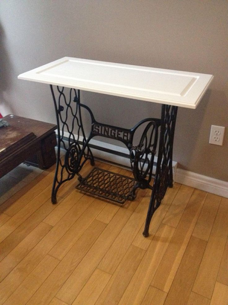 Thrifting success! Wrought iron singer sewing table base with upcycled cabinet door. Result is awesomeness.