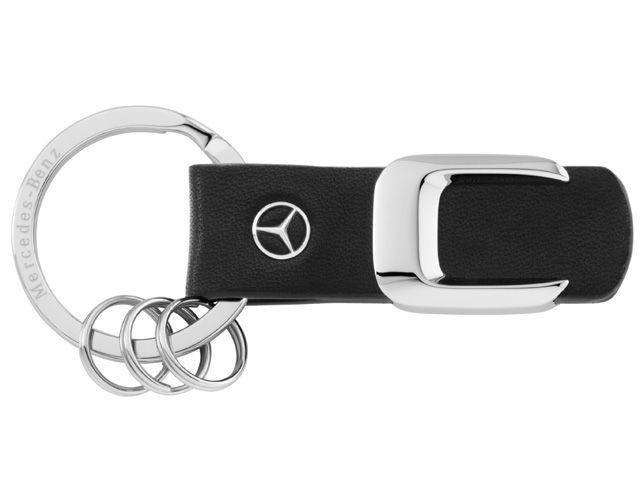 B66957942  Model series key ring. Black/silver. Leather/stainless steel.  Scale replica of lettering on rear of vehicle.  Laser-engraved flat split ring. 3 mini split rings for quick replacement of keys.  Star logo stud in leather.