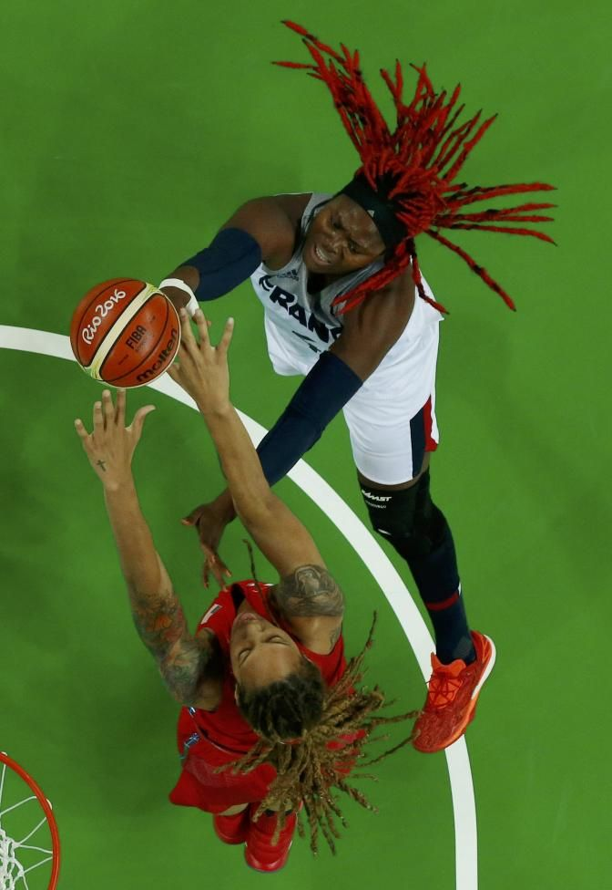 Isabelle Yacoubou of France shoots past Brittney Griner of USA in women's basketball semifinal. REUTERS/Jim Young