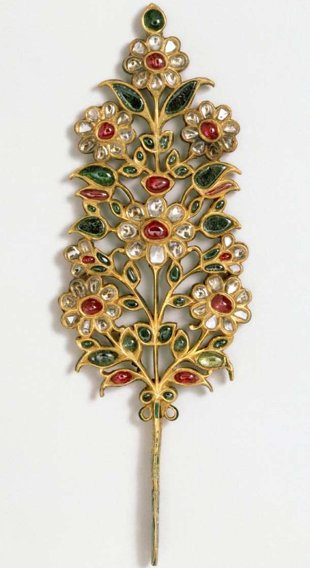 Turban ornament, India, early 18th century -- set with rubies, emeralds, pale beryls and diamonds.