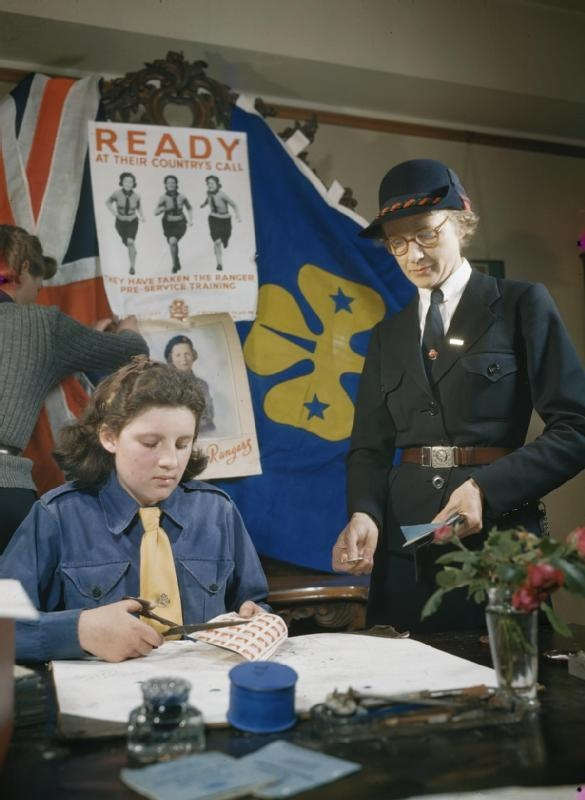 The Girl Guides; A Guide-Leader buys saving stamps from a Girl Guide, 1944. During the war, the public were encouraged to save their money rather than spend it. Organisations like the Girl Guides sold savings certificates and saving stamps. Savings groups made it easy to save regularly and special campaigns, such as War Weapons Weeks, helped to keep enthusiasm alive.