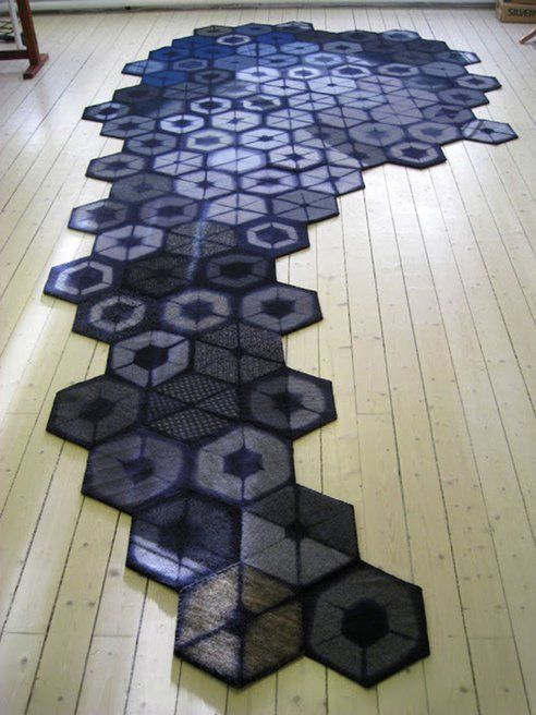 I am in a swoon over this sensational rug fabricated from Thrift store cast-offs.  What creativity and execution!