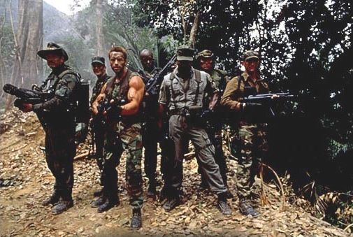 The main cast of Predator. Left to right: Ventura, Black, Schwarzenegger, Duke, Weathers, Landham, and Chaves.