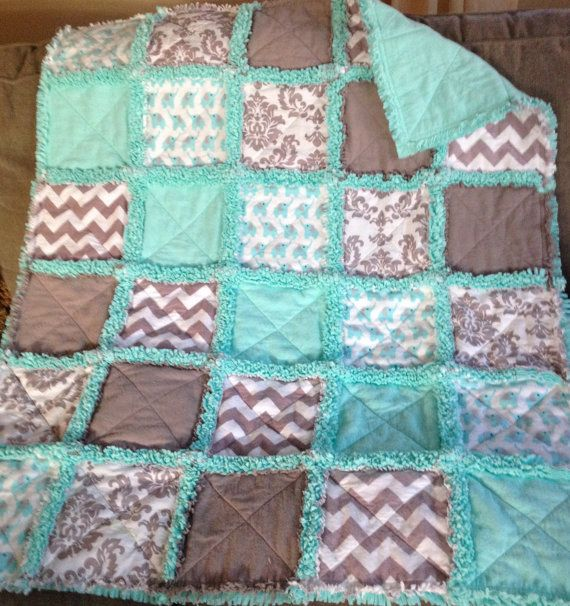 Ready to Ship Here is a cute baby elephants rag quilt in turquoise and gray. It features baby elephants, chevrons and a damask print in flannels and cottons on the top. The middle and bottom layer is a matching turquoise teal in flannel and fleece giving a nice fluffy turquoise seam.