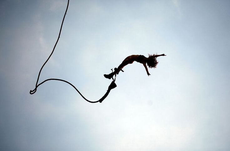 A festival attendee in mid-bungee-jump, during the 17th Woodstock Festival in Kostrzyn-upon-Odra River, Poland, on August 6, 2011