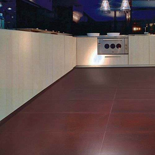 Porcel-Thin Umber oxide red metallic ultra-thin porcelain tiles from the Province tile collection in a modern kitchen. #metallic #kitchen #tiles