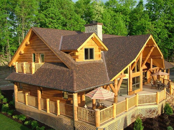 The Big Sky is one of the most gorgeous log homes and that PORCH....   #logcabin #loghome #cabin