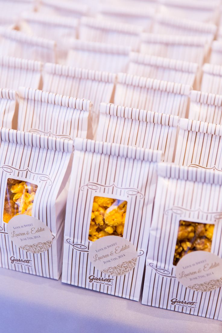 """I wanted to leave guests with a favor that was classic Chicago and that they could eat right away or for breakfast the next day,"" Lauren says. ""We gave individual Garrett popcorn bags, with cute stickers that went with our stationery."""