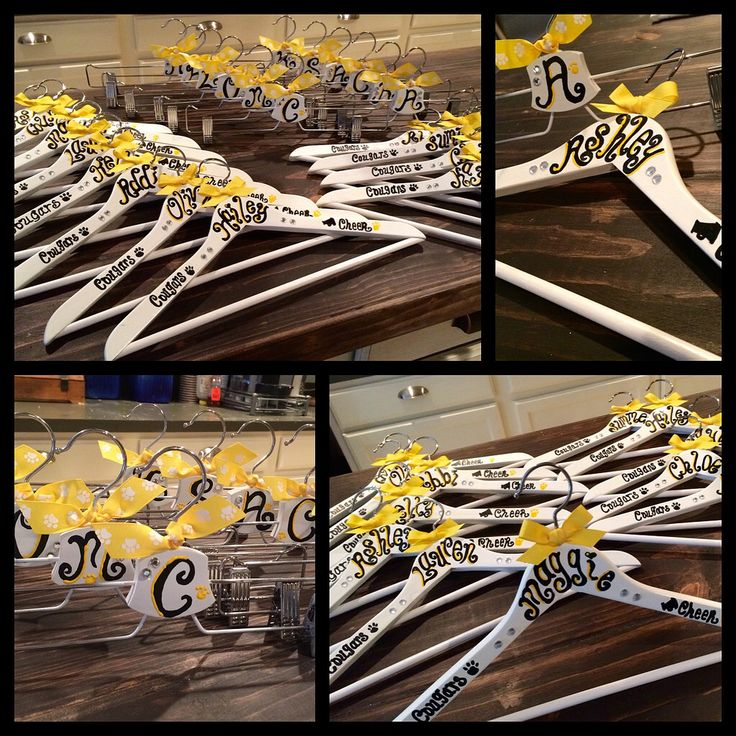 Cheer team uniform hangers personalized.  Bought the hangers at IKEA 8 for $4.99 (shirt) and the skirt hangers for $.99 each. The shirt hangers come in white, black or nude.  The skirt hangers only come in nude so I had to spay paint those white to match and then used paint marked to do the names. Added some bling and brushed very lightly with an oil based clear finish to protect the lettering.