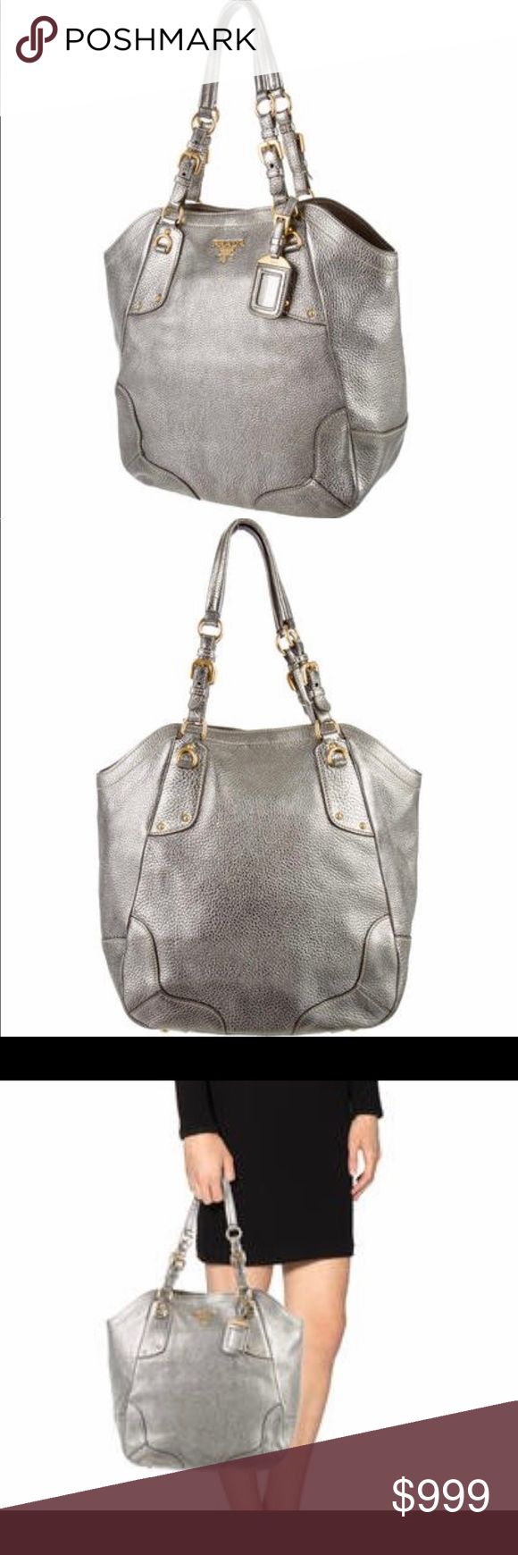 """*AUTHENTIC* Prada Acciaio Vitello Diano Tote Acciaio Vitello Daino leather Prada tote with gold-tone hardware, dual flat shoulder straps, gold-tone logo embellishment at front face, beige jacquard nylon lining, dual pockets at interior walls; one with zip closure and magnetic snap closure at top. Shoulder Strap Drop: 8.5"""", Height: 13"""", Width: 15"""" Depth: 5.5"""", Condition: Very Good. Faint surface scratches at hardware; faint scuffing at corners; faint marking at interior. Prada Bags Totes"""