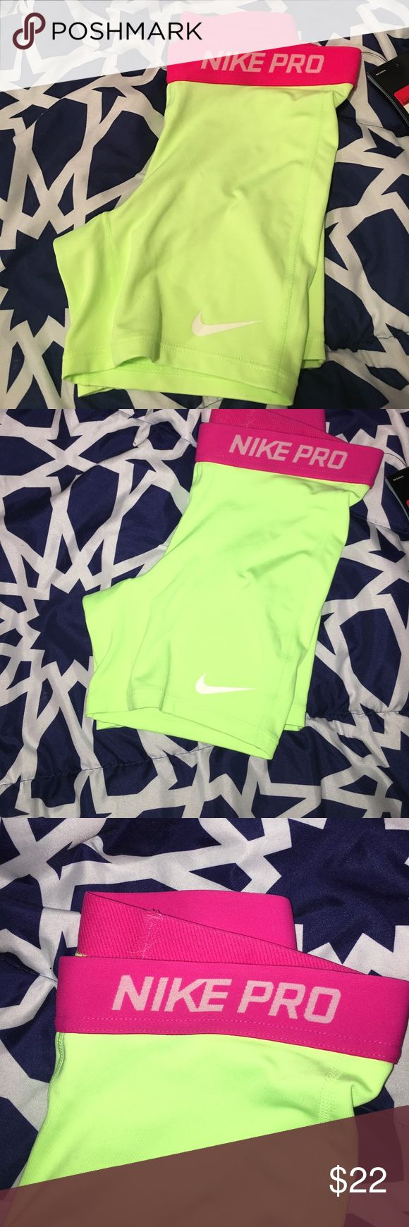 Nike Pro shorts New Nike Pro Dri-fit shorts, green with pink waist, size L in girls but will fit small and xs women. Nike Shorts