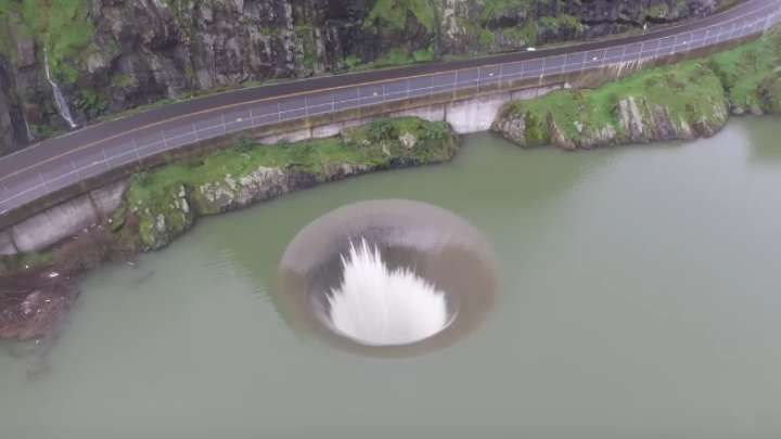 "It might look like you're staring straight into the underworld's abyss, but fear not, it's actually the ""Glory Hole' – an affectionately nicknamed spillw"
