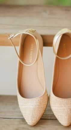 Neutral flats with an ankle strap.