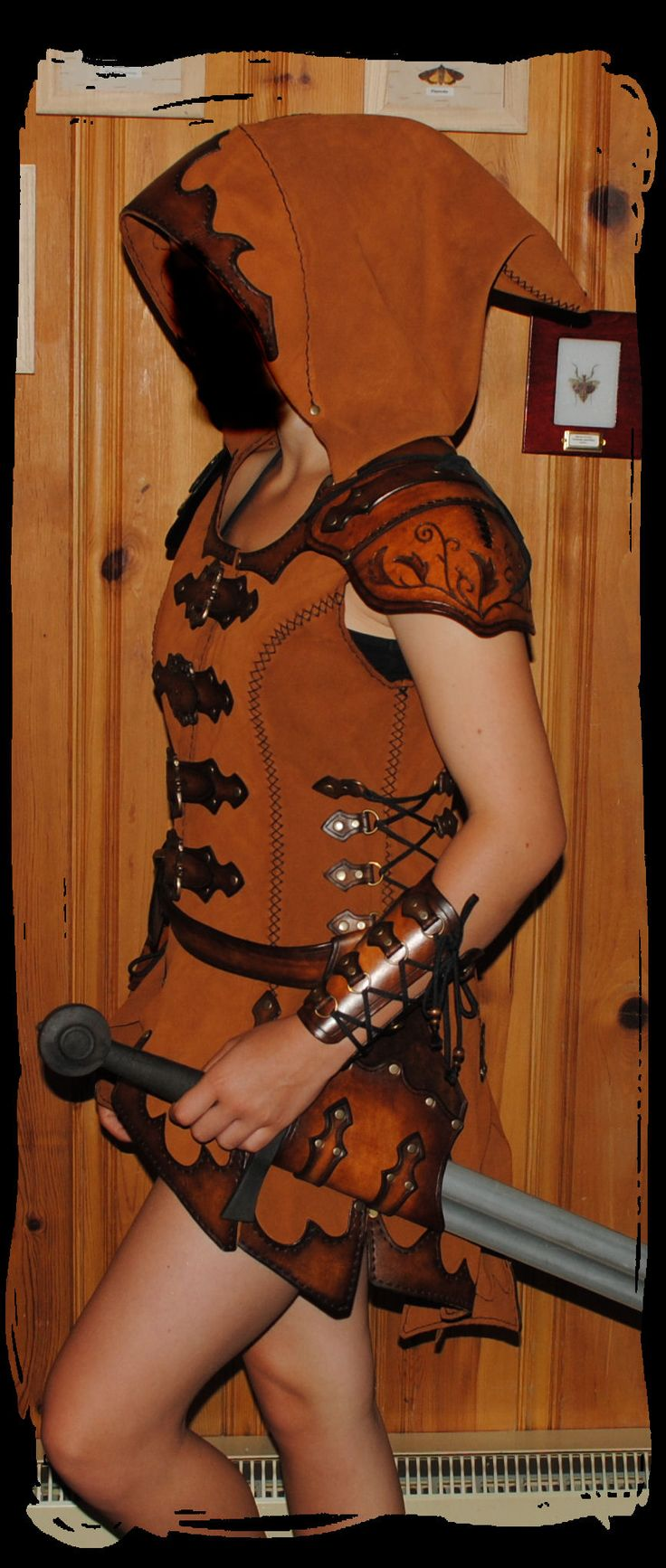 archer leather tunic by Lagueuse cosplay costume LARP equipment gear magic item | Create your own roleplaying game material w/ RPG Bard: www.rpgbard.com | Writing inspiration for Dungeons and Dragons DND D&D Pathfinder PFRPG Warhammer 40k Star Wars Shadowrun Call of Cthulhu Lord of the Rings LoTR + d20 fantasy science fiction scifi horror design | Not Trusty Sword art: click artwork for source