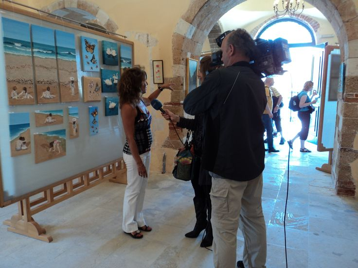 Giving an interview to a local Greek TV station at an exhibition in Chania.
