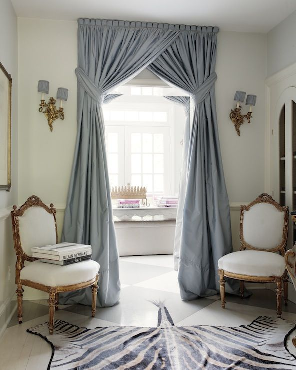 very glamourous criss cross curtains the pearl blue with the high tie back makes this curtain stand out against the rug when looking at the symetry the