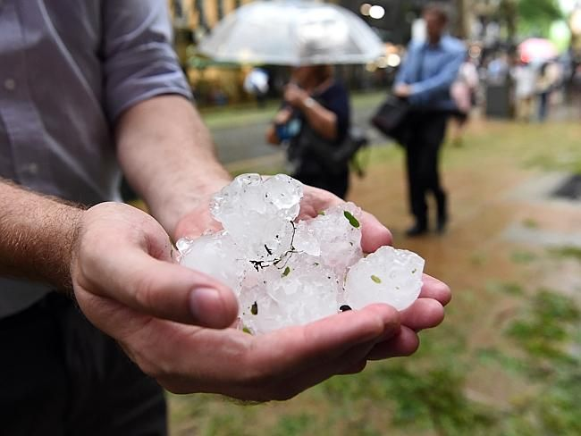 Golf-ball-size hail stones hit Brisbane after a severe thunderstorm swept through the city after it was hit by a storm on 27/11/2014.