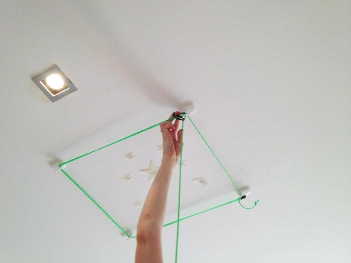 How to hang blanket forts from the ceiling - hook and cord formation.
