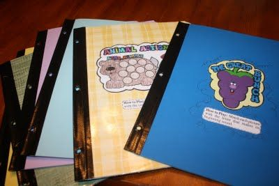 put duct tape one the spine of your file folder games then punch holes in them and keep them in a three ring binder...this is genius! great space saver idea!