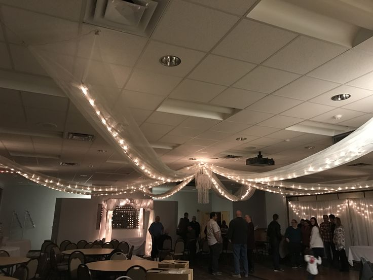 Ceiling Drapes with lights By D.I.Y. Rentals
