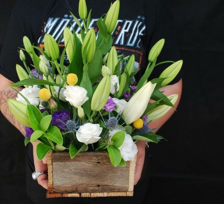 Flower Box Bettie bee blooms. White lillies, billy buttons, purple Lisianthus, white Lisianthus, blue seaholly.