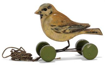Steiff painted wooden Pick-Sparrow on wheels. Black glass eyes, wire frame, green wooden wheels, black and white cord and FF button, 4½ inches. (11.5cm.) high, circa 1920.