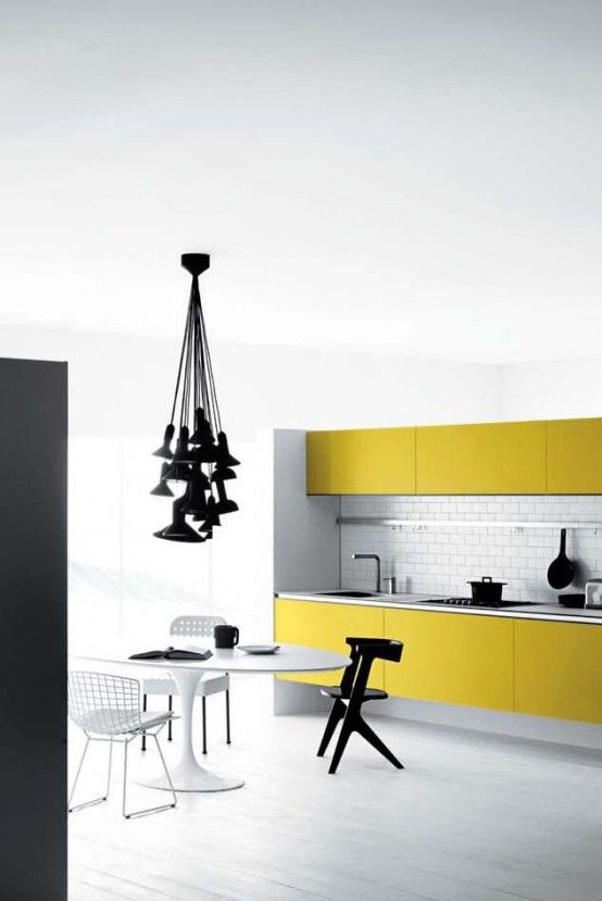 Yellow and black kitchen. Photo by Meson Kitchens.