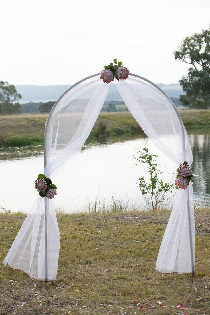 Gorgeous ceremony arch decorated with tulle and king for Arch decoration supplies