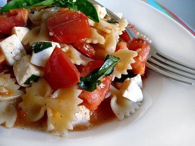 Pasta with Fresh Basil, Tomatoes, and Mozzarella | Good Life Eats - I made this for dinner on 7/27/13, it was a winner!  Very easy to make, very quick, the flavor was subtle, but tasty.  I used my home grown tomatoes and basil and I did add mushroom and fresh, home-grown oregano to the recipe, I also substituted gluten free pasta,  but other than that, I followed the recipe exactly and got lots of compliments on it.  I'll be making it again.