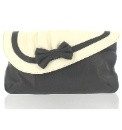 Marta Jonsson multi leather bag  Product Code: NM556MC   Product Details  Delivery / Returns  Black & cream leather clutch bag with bow detail  Designed by Marta, made in Portugal using the finest quality leather  Matching items available  HWD: 14x25x2cm  Upper: Leather  Lining: Satin  This item is despatched direct from the manufacturer