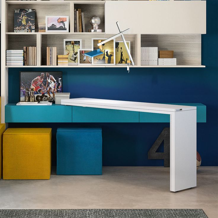Giro features a rotating mechanism that allows the table to swing out from the wall and has an accessible drawer when closed for additional storage.