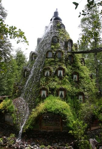 Magic Mountain Lodge, tucked away inside of the Huilo Huilo biological reserve in the Patagonian Andes of southern Chile, lets visitors soak in nature's beauty from their bedside