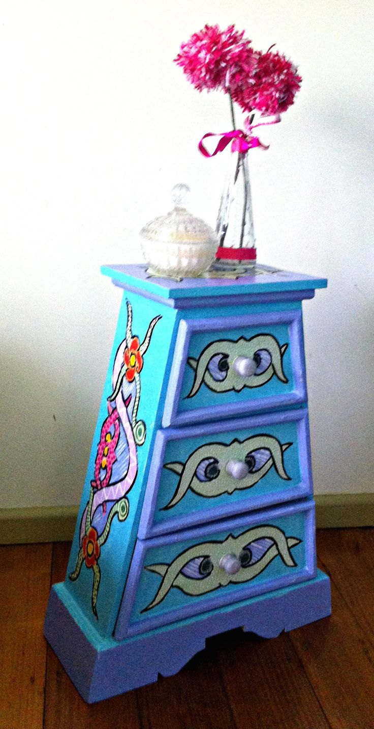 I found this Funky little cabinet on eBay. The scroll designs were already etched into the wood. So....just needed to add some colour. This cute little piece sold pretty quickly on eBay.