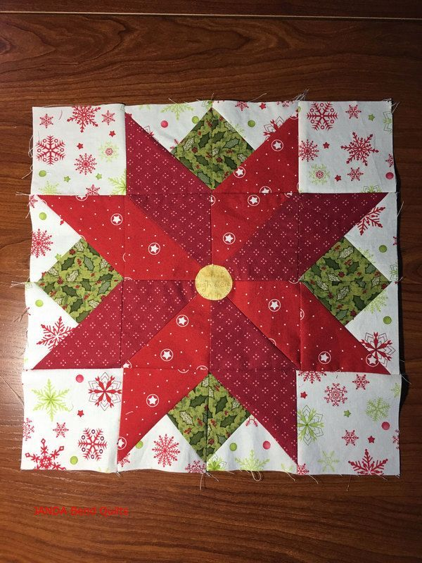 Block 7 is here in the I Wish You a Merry Quilt-A-Long, and it is Poinsettia by Sandy Maxfield!  This is a super fun block made with half square triangles.. You can find the pattern at Sandy Star Desi