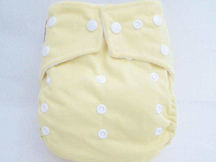 Original Cross-Over Squared Tab Snap cloth diaper.  Color: Soft Yellow.